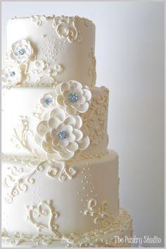 lovely white and aqua wedding cake