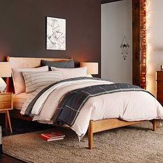 Mid-Century Bed - Acorn   $799 for Twin   Simple and sophisticated. Crafted of FSC®-certified wood, the Mid-Century Bed brings 50s and 60s style to the bedroom. With its streamlined headboard and gently tapered legs made of solid eucalyptus wood, its refined profile suits any style.