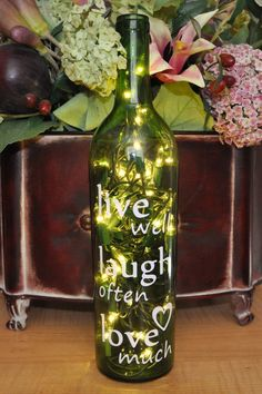 Wine Bottle #diy decorating ideas / To set outside on the table during summer nights ( use lights with battery pack/homecoming sets work)