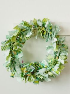 Upcycle odd bits of fabric into a cute holiday wreath. A great project for kids or beginning crafters, this easy-to-make fabric wreath requires no sewing.