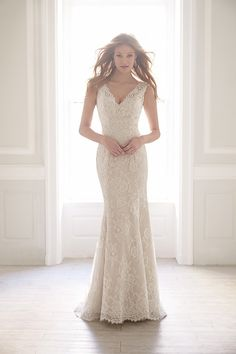 MJ152 Madison James Wedding Dress - Float down the aisle in this creamy lace wedding dress.