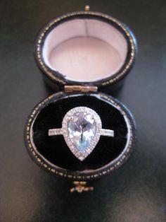 Pear Cut Aquamarine with Round Diamonds