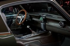 Ford Mustang 'Espionage' Makes Other Muscle Cars Look Tame Restomod Mustang, 1965 Mustang, Ford Mustang Fastback, Mustang Interior, Gone In 60 Seconds, Custom Consoles, Triumph Motorcycles, Custom Motorcycles, Performance Cars