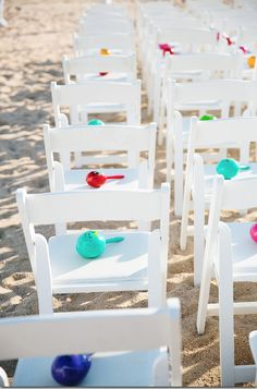 For a Mexican beach wedding, place colorful maracas on the chairs for each of your guests.