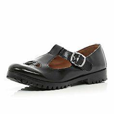 Black patent T bar cut out shoes €43.00