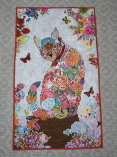 Purrfect Kitty Quilt. Pattern from Laura Heine. Made it my own by adding more flowers in the borders of the kitty. finished 2/27/17 MRR