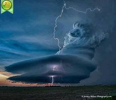 A uniquely formed Cumulonimbus cloud over Greece, with spectacular lightening.