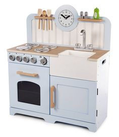 Designed with a taller work surface for extra years of play, this country kitchen features a pretend oven and hob with clicking dials, storage cupboards, a Belfast sink, clock and utensil shelves. Kids Play Kitchen, Play Kitchens, Toddler Kitchen, Smart Kitchen, Wooden Toy Kitchen, Wooden Toys, Oven And Hob, Bleu Pastel, Chuck Box