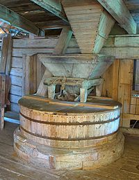 A gristmill, aka: grist mill, corn mill or flour mill; grinds grain into flour. The term can refer to both the grinding mechanism and the building that holds it.- Old Swedish gristmill. Wikipedia, the free encyclopedia