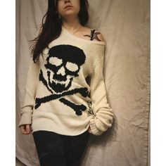 Cross bone skull sweater. Black and white skull/skeleton sweater, from Hot Topic. It's a size XS, although could fit a small as well. New without the tags and no flaws. I paid 45$ for it, but I'm open to offers :) Hot Topic Sweaters Crew & Scoop Necks