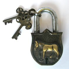 "Brass and steel padlock with horse. Dimensions: 2.5""L x 1""W x 4.5""H"