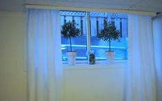 DIY UNFINISHED BASEMENT DECOR: white basement window curtains with plant pot