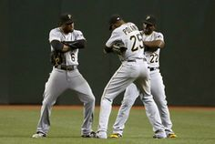 Pittsburgh Pirates' Starling Marte (6), Gregory Polanco (25) and Andrew McCutchen (22) celebrate after a baseball game against the Arizona Diamondbacks on Saturday, April 25, 2015, in Phoenix. The Pirates defeated the Diamondbacks 2-1. (AP Photo/Ross D. Franklin)
