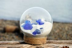 Fill your heart with memories of the ocean by gazing into this sand and seaglass filled globe.