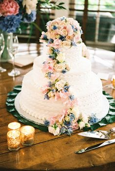 Wedding Cake with Blue and Pink Flowers | photography by http://www.ariellephoto.com