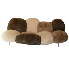 "TITLE:	 Sofa ""Cipria"" by The Brothers Campana. CREATOR:	 Fernando and Humberto Campana (Designer) OF THE PERIOD:	 Mid-Century Modern COUNTRY:	 Brazil DATE OF MANUFACTURE:	 circa 2009 MATERIALS:	 faux fur over gellyfoam and dacron wadding metal frame"