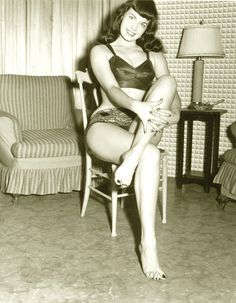 """Bettie Page (April 22, 1923 – December 11, 2008) was an American model who gained a significant profile in the 1950s for her pin-up photos. Often referred to as the """"Queen of Pinups"""", her jet black hair, blue eyes, and trademark bangs have influenced artists for generations. Bettie was photographed by Irving Klaw and Bunny Yeager at numerous locations but never in Bury St. Edmunds, Suffolk www.EricYoungPhotography.co.uk"""