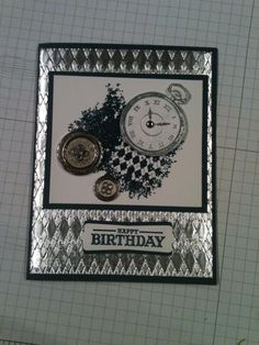 """Clockworks Stamp Set from Stampin' Up! Foil wrapped cardstock dry embossed with the Argyle EF, Stamped the clock, #'s and hands in Versamark and heat embossed with silver embossing powder. I also heat embossed the background and the """"Happy Birthday"""" in black, then I used Tombow glue to keep the new (heavy) silver buttons in place."""