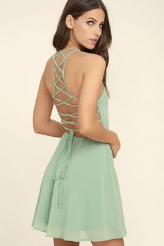 Lulus Exclusive! Reward your good behavior with a treat like the Good Deeds Sage Green Lace-Up Dress! Dreamy, lightweight Georgette sweeps across a princess-seamed bodice and strappy apron neckline, plus a lacing open back. Full skater skirt has a bit of elastic at back. Hidden back zipper.