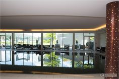 Indoor pool with lake view at Acquapura Spa - Spa and wellness at Falkensteiner Schloss Hotel Velden at Wörthersee in Austria - #wellness #spa