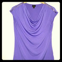 Beautiful zipper sleeve blouse This is a great top! Can be perfect for work or for a night out... NWOT. never worn. Tops