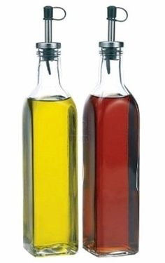 This glass oil and vinegar set is a great way of   storing a multitude of products in a convenient and   practical way. Each dispenser has a 16 ounce   capacity and comes with a silver and black spout.