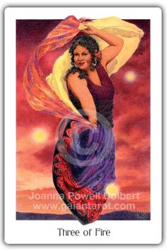 "Three of Fire (3 of wands) Gaian Tarot by Joanna Powell Colbert ""A woman dances with billowing scarves, as a blazing sunset turns the evening sky into an inferno. She herself blazes too, with passion and personal power. Her crackling, magical energy even draws three ""great balls of fire"" into her sphere!"" http://www.gaiantarot.com/threeoffire/#sthash.fQycKwXG.dpuf"