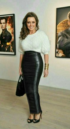 Carol Vorderman wearing a long black leather hobble skirt