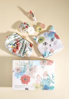 Wow! This cosmetic set includes a floral tote, a clutch, a lipstick holder, and a compact. It even comes with lipstick and blush. This would make a beautiful gift for any cat owner.