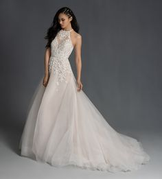 Style 6952 Stella Hayley Paige bridal gown - Ivory floral baroque beaded gown, scalloped jewel neckline and keyhole t-strap back, modified A-line skirt with embroidered accent and cashmere lining.