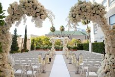 Larger-than-life floral structures created an urban wonderland at this Mindy Weiss @Beverly Wilshire (A Four Seasons Hotel) wedding.