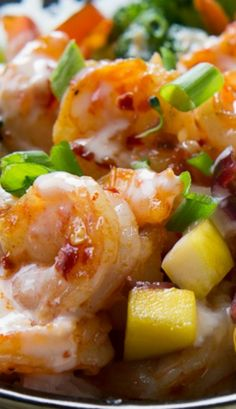 Sweet Fire Shrimp Bowl ~ boasts loads of tender crisp veggies, a sweet mango cranberry salsa, shrimp tossed in a spicy chili garlic sauce, and drizzled with a cooling sweet chili yogurt all over a bed of rice.