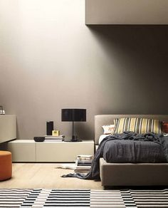 Soft Grey Wall Scheme and Modern Corner Bed in Small Bedroom