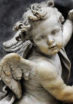 Beautiful Cherub seems to be carved of marble