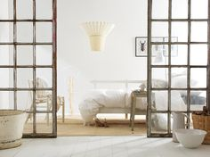 Rustic charm. Love repurposed windows as a bedroom divider.