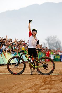 Nino Schurter of Switzerland celebrates winning gold during the Men's…