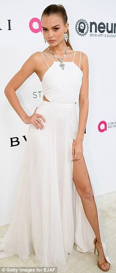 Caitlyn Jenner takes plunge at Sir Elton John's annual Oscars bash #dailymail