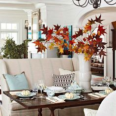 Pull a settee up to the dining table for comfy twist on dining and use a branches from the yard for a centerpiece.