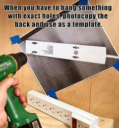 When you have to hang something with exact holes, photocopy it first to use as a guide