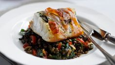 Prosciutto baked Norwegian Cod with warm spinach & puy lentil salad