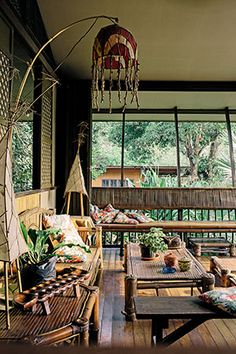 Art and native elements, colorful pillows, Wendy's bamboo-and-paper lamps make this airy and cozy room inviting. Bamboo House Design, Tropical House Design, Tropical Interior, Tropical Style, Tropical Houses, Filipino Interior Design, Home Interior Design, Filipino Architecture, Architecture Design
