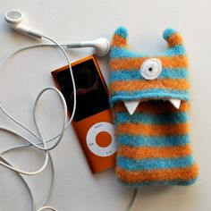 This little monster is made to nuzzle and protect your i-Pod or MP3 player. It is sized to fit the i-Pod Nano or an iPod Shuffle--just open the
