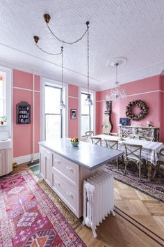 A pink kitchen and dining room in a renovated 1880s Victorian townhouse