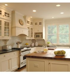 Like some glass cabinets with the honed granite counter tops and butcher block island