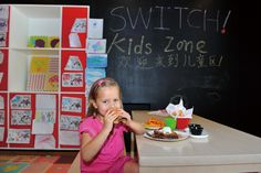 Switch Cafe! has a Kids Zone with coloring sheets and a chalk board in addition to child-friendly food