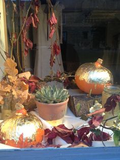 The White Rose bridal boutique, Chipping Campden. October, Autumnal window display.