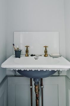 Love this antique scalloped sink with vintage brass hardware.
