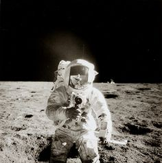 Space: An Apollo 12 crewmember using a video camera on the moon in November 1969