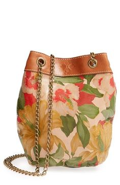 Patricia Nash 'Spring Lily - Ibiza' Convertible Shoulder Bag at Nordstrom.com. Tawny Italian leather with a burnt-edge finish is painted in gorgeous blooms that lend visual dimension to a sleek shoulder bag in a chic, pouchette silhouette. A pull-through chain strap adjusts from shoulder to crossbody length, providing versatile styling options.
