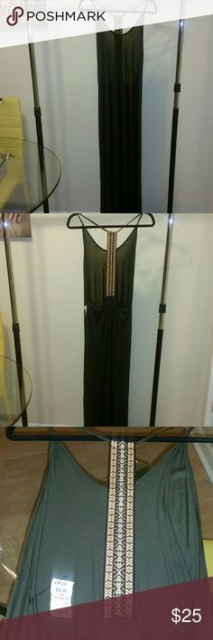 AKIRA T-BACK TRIBAL MAXI DRESS Olive green T-BACK Tribal Maxi dress. Great for the perfect beach getaway or pool party. It's a T-Back so all of your back and side of your breast area may be exposed depending on physique :-). AKIRA Dresses Maxi